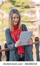 Young business woman using tablet outdoor ...