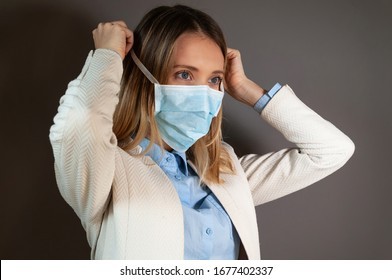 Young business woman wearing protective mask