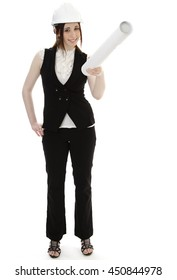 Young business woman wearing a business suit and construction had holding a white tube and pointing up against a white background