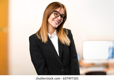 Young business woman winking on unfocused background