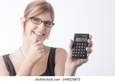 Young business woman is working with a calculator