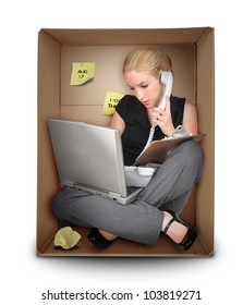 A young business woman is working on a laptop and talking on a phone in a box representing a small office. Use it for a job occupation or entrepreneur concept.