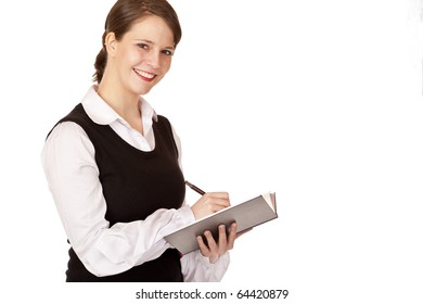 Young business woman writes on notepad. Isolated on white background.