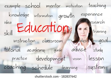 Young business woman writing education concept. Office background.