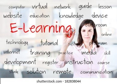 Young business woman writing e-learning concept. Office background.