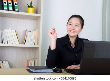 Young business women working with laptop ,having thought.
