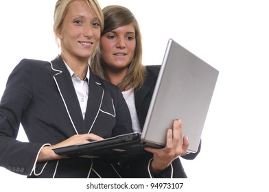 Young business women working with laptop, white background