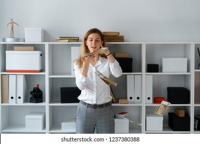 young businesslady in office make good bargain have big profit fling money sudden wealth concept