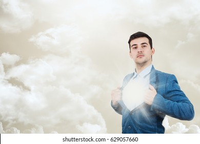 Young businessman acting with courage like a super hero and tearing his shirt off. Proud of yourself emotion isolated on white background.Believe in yourself.