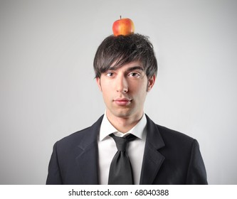 A young businessman with an apple on his head