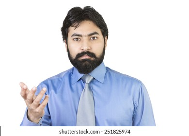 Young businessman asking question on white background