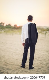 young businessman in a beach