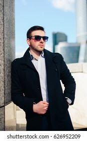 young businessman with a beard and glasses