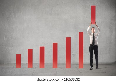 Young businessman being part of a chart