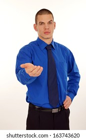 Young businessman at blue shirt and tie shows his palm.