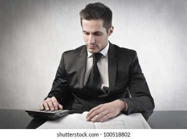 Young businessman budgeting