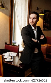 Young businessman in a cafe.
