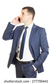 Young businessman calling on mobile phone and looking to the side