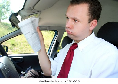 Young businessman in the car try to cool himself on the hot sunny day
