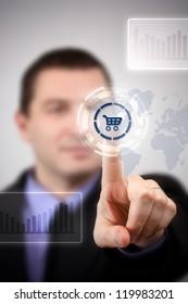 Young businessman choosing shopping cart symbol