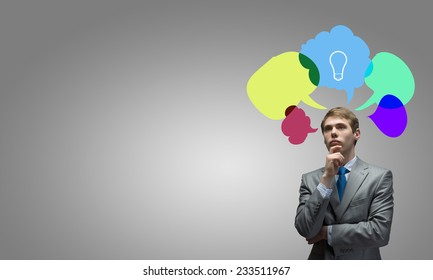 Young businessman and colorful thoughts above her head
