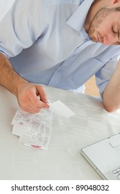 Young businessman concerned about invoices