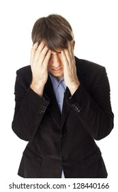 Young businessman covering his face with his hands isolated on white background