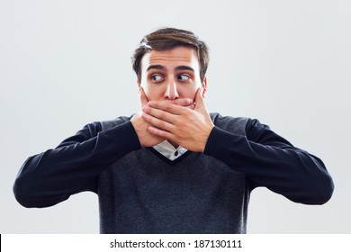 Young businessman covering mouth with hands,I will not say anything!