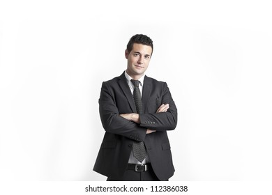 A young businessman with crossed arms