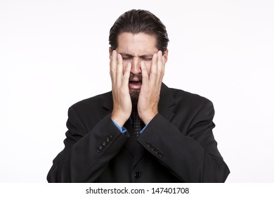 Young businessman crying against white