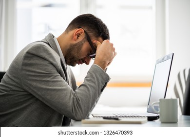 Young businessman is depressed at his job.