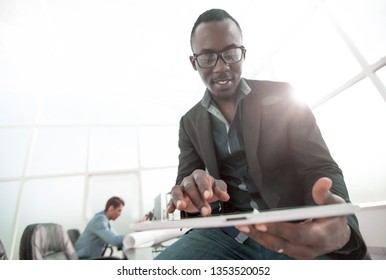 young businessman with digital tablet sitting on office Desk