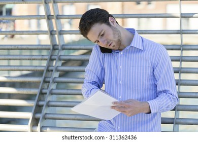 Young businessman discussing business while on the go.