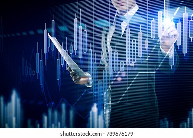 Young businessman with document in hand drawing abstract forex chart on dark blue background. Marketing concept. Double exposure