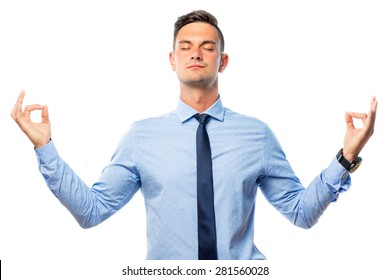 Young businessman doing relaxation exercise