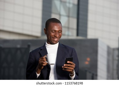 young businessman drinking coffee in town and using a smart phone. Business Concept, Lifestyle and Mobility in Communication