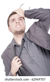 A young businessman employee is getting a headache from all the stress