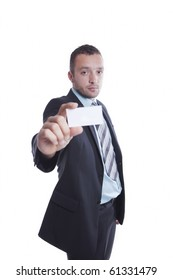 Young businessman with empty business card