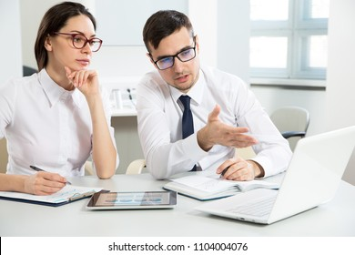 Young businessman explains to colleague a new project