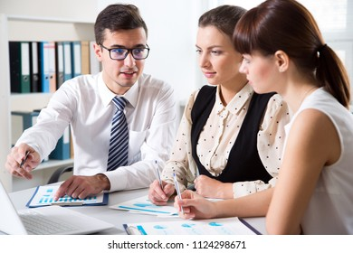 Young businessman explains to colleagues a new project