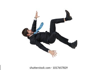 Young businessman falling down in free fall. Isolated on white background.