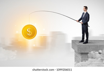 Young businessman fishing coins from a foggy city concept