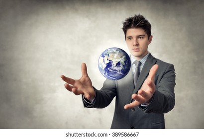 Young businessman floating the planet with their hands