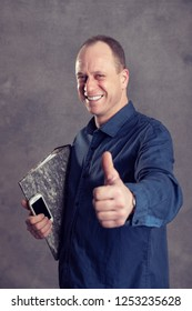 young businessman with folder,  phone and thumb up