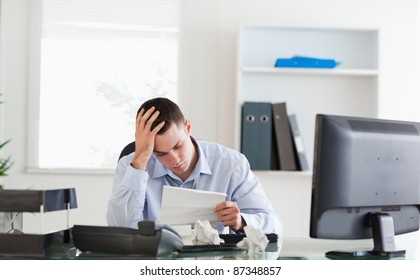 Young businessman getting frightening bad news