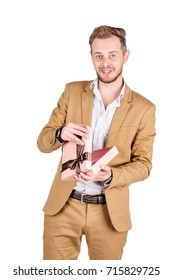 young businessman with gift box on white background. human emotion facial expression reaction attitude.  emotion expression and lifestyle concept.