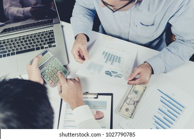 Young businessman give suggestion to home buyer customer about interest loan money and tax of real estate home before signed in the contract  and paying down payment to realtor
