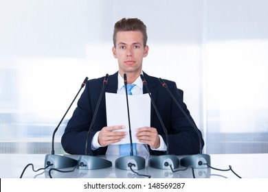 Young Businessman Giving Speech In The Conference