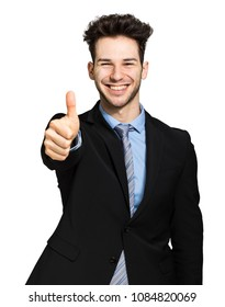 Young businessman giving thumbs up