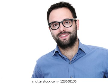 Young businessman with glasses looking at camera. Isolated studio shot